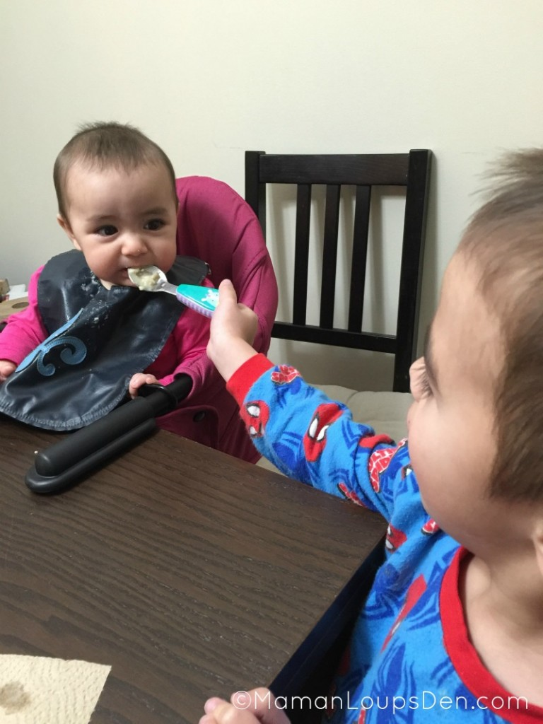 Cub feeds his sister in the Guzzie + Guss chair