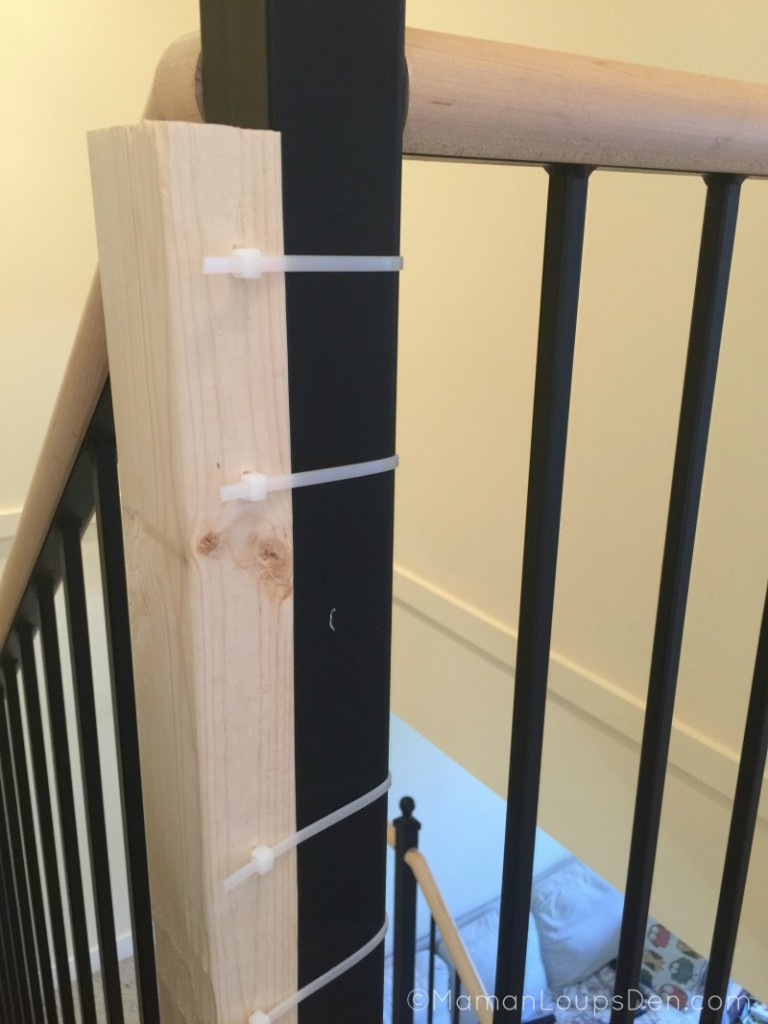 Wood attached to banister with zip ties